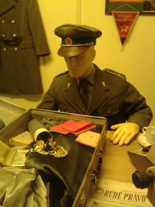 A figure of a border guard finding smuggled jewelry
