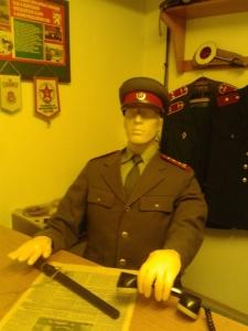 A Communist official reading a Communist paper