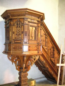 The pulpit with intarsia in the Holy Trinity Church
