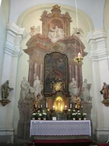 The painted main altar of the Church of Saint Alois