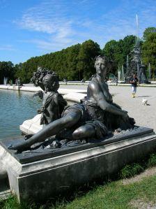 A statue adorning a fountain in the garden