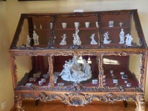 Meissen porcelain in a Rococo cabinet