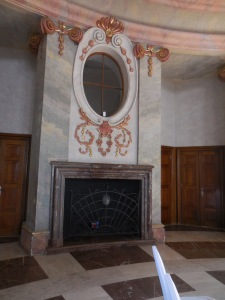 A fireplace in Marble Hall